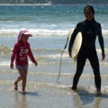 Yumi being held by me as I take the photo. Maki's first surf after baby!